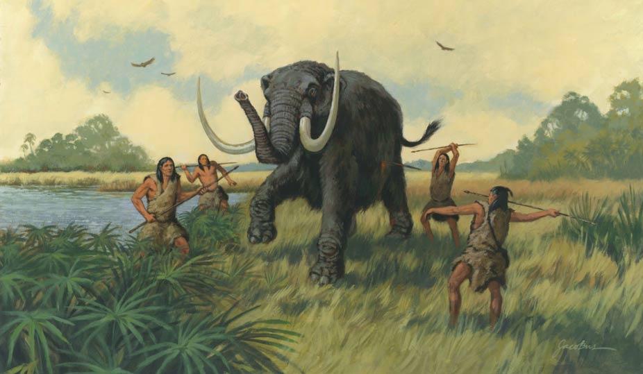 Mamutu avlamak üzere olan bir grup insan.